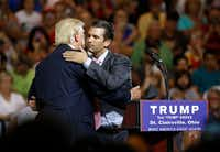 Donald Trump hugs his son Donald Trump Jr. during a presidential campaign rally at Ohio University Eastern Campus in St. Clairsville on June 28, 2016.(Patrick Semansky/The Associated Press)
