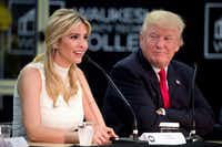 President Donald Trump listens as his daughter Ivanka Trump speaks at a workforce development roundtable at Waukesha County Technical College in Pewaukee, Wis., in June. (Andrew Harnik/The Associated Press)