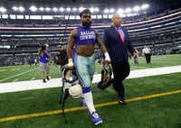 With Los Angeles Rams running back Todd Gurley's jersey in hand, Dallas Cowboys running back Ezekiel Elliott (21) walks to the locker room after their 35-30 loss at AT&T Stadium in Arlington, Texas, Sunday, October 1, 2017. (Tom Fox/The Dallas Morning News)(Tom Fox/Staff Photographer)