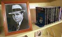 A picture of Robert  E. Howard sits on the shelf of the library along with some foreign editions of his books in Cross Plains.(Carol T. Powers/(DMN file) )