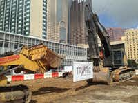 Construction has started on a garage, retail and residential building next to the Statler project on Harwood Street.(Steve Brown/Staff)