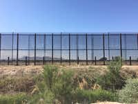 The border fence in Tornillo, Texas, is on private land owned by a West Texas pecan farmer. Mountains in Mexico are visible through the 18-foot fence.(Angela Kocherga/Staff)