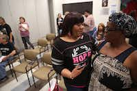 Barbara Edwards, a breast cancer survivor, talks to her friend and fellow survivor Amelia Washington, right, after a cooking class at Cvetko Patient Resource Center at Baylor University Medical Center in Dallas.(Rose Baca/Staff Photographer)