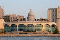 Swimmers pass in front of Monona Terrace in Madison as the Wisconsin state capitol is seen in the background during an Ironman competition in September.(Jamie Squire/Getty Images)