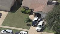 Police investigate a body found at a house in the 6400 block of Woodway Drive in Fort Worth.(KXAS-TV (NBC5)/Courtesy)