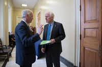Sen. Ron Johnson, R-Wis., (left) chairman of the Senate Homeland Security and Governmental Affairs Committee, confers with Senate Majority Whip John Cornyn, R-Texas. (J. Scott Applewhite/The Associated Press)