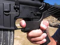 "A bump stock uses the recoil of a semiautomatic rifle to let the finger ""bump"" the trigger repeatedly so that it fires shots in rapid succession. Despite its firepower, a rifle with a bump stock is different from a fully automatic machine gun, which is illegal for most civilians to own.(Allen G. Breed/The Associated Press)"
