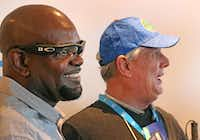 "Cowboys Hall of Famer Emmitt Smith visits with Pete Lane, whom he helped ""see"" the game with the use of Aira technology for the blind and visually impaired.(Louis DeLuca/Staff Photographer)"
