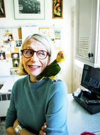 The cartoonist Roz Chast in her kitchen with her caique, Jacky, one of two resident parrots, at her home in Ridgefield, Conn., April 10, 2014.  (RANDY HARRIS/NYT)