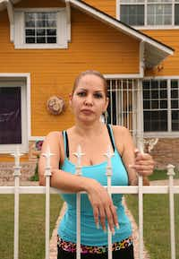 Erika Denova poses for a photograph at her home in South Dallas on Aug. 23, 2017. Denova was one of dozens of victims of a wide-ranging property fraud scam targeting vulnerable people in southern Dallas County in recent years. (Rose Baca/Staff Photographer)