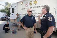 Rockwall City Council member Kevin Fowler (center) talks to Rockwall Police Chief Kirk Riggs during a National Night Out event.(2015 File Photo/Staff)