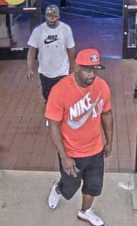 Surveillance image of two suspects in a purse snatching.