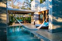 """<p>The 40 villas at Chabl<span style=""""font-size: 1em; background-color: transparent;"""">é</span><span style=""""font-size: 1em; background-color: transparent;"""">Resort, near Merida, Mexico offer niceties like private pools, verandas, hammocks and artisan furniture.</span></p>(Michael Hiller/Special Contributor)"""