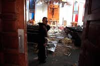 Fr. John Tran Nguyen looks around the heavily damaged St. Peter Catholic Church in Rockport on Sept. 14. The church was damaged during Hurricane Harvey.(Rachel Denny Clow/Corpus Christi Caller-Times)