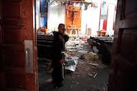 Fr. John Tran Nguyen looks around the heavily damaged St. Peter Catholic Church in Rockport on Sept. 14. The church was damaged during Hurricane Harvey.(Rachel Denny Clow/Corpus Christi Caller-Times)