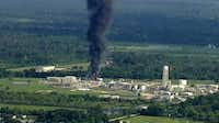 Smoke rises from a chemical plant in Crosby, near Houston. Nearly 20 Houston-area residents say test have detected toxic substances in soil, water and ash samples taken miles from the chemical plant that flooded during Hurricane Harvey, caught fire and partially exploded.(The Associated Press)