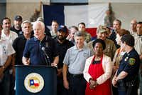 In this file photo, Sen. John Cornyn is surrounded by fellow lawmakers and law enforcement as he addresses a press conference at the evacuation center at NRG Center on Monday, Sept. 4, 2017, in Houston. A group of elected officials met with evacuees and held a brief news conference in an effort to drum up support for emergency aid for Harvey victims. (Smiley N. Pool/The Dallas Morning News)(Smiley N. Pool/Staff Photographer)