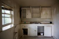 This is the kitchen of the HMK rent house Fernando and Yolanda Gonzalez plan to move into in West Dallas. The couple must leave  their current HMK rent house on McBroom Street because the landlord wants to redevelop there. (Rose Baca/Staff Photographer)