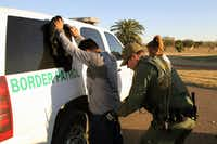 A Border Patrol agent takes a Mexican man into custody in February 2016 for illegally entering the U.S. by crossing the Rio Grande near Rio Grande City, Texas. (2016 File Photo/Getty Images)