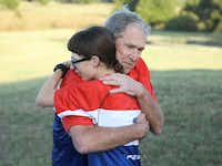Former Pres. George W. Bush greets a participant in the Warrior 100K. (Paul Morse/The Bush Center)