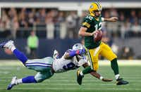 "<p><span style=""font-size: 1em; background-color: transparent;"">Green Bay Packers quarterback Aaron Rodgers escapes the grasp of Dallas Cowboys defensive tackle David Irving before running 18 yards for a first down on a third down play during the Packers' game-winning drive in the final minute of the fourth quarter Sunday at AT&T Stadium.</span></p>(Vernon Bryant/Staff Photographer)"