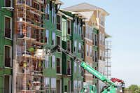 Construction work on an apartment complex in Frisco.(Vernon Bryant/Staff Photographer)