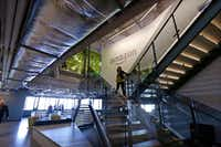 An Amazon worker walks down steps in the company's Seattle office.(Elaine Thompson/The Associated Press)