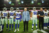 Dallas Cowboys owner Jerry Jones and head coach Jason Garrett stand with the team for the playing of the  National Anthem before a game at AT&T Stadium in Arlington.(Andy Jacobsohn/Staff Photographer)