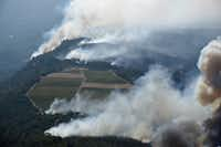 Smoke rises as a wildfire burns in the hills north east of Napa, Calif., Monday, Oct. 9, 2017. Wildfires whipped by powerful winds swept through Northern California sending residents on a headlong flight to safety through smoke and flames as homes burned.(Michael Short/San Francisco Chronicle)