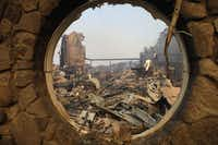 The fire-ravaged Signorello Estate winery is seen through a window Monday, Oct. 9, 2017, in Napa, Calif. Wildfires whipped by powerful winds swept through Northern California sending residents on a headlong flight to safety through smoke and flames as homes burned.(Marcio Jose Sanchez/AP)