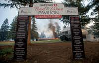 A tent structure built for the 2017 Safeway Open burns on a golf course at the Silverado Resort and Spa in Napa, California on October 9, 2017, as multiple wind-driven fires continue to whip through the region.(JOSH EDELSON/AFP/Getty Images)