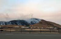 In this photo provided by the Sonoma Raceway, a wildfire burns behind the Sonoma Raceway on Monday, Oct. 9, 2017, in Sonoma, Calif. Wildfires whipped by powerful winds swept through Northern California early Monday, sending residents on a headlong flight to safety through smoke and flames as homes burned.(Steve Page/Sonoma Raceway)