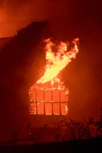 Flames shoot out from a window as the Signorello Estate winery burns in the Napa wine region of California on October 9, 2017.(JOSH EDELSON/AFP/Getty Images)