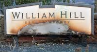 A partially burned sign is seen amidst smoldering remains at William Hill Estate Winery in Napa, California on October 9, 2017, as multiple wind-driven fires continue to whip through the region.(JOSH EDELSON/AFP/Getty Images)