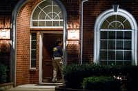 Members of an FBI evidence response team enter the family home of Sherin Mathews in the 900 block of Sunningdale in Richardson.(Smiley N. Pool/Staff Photographer)
