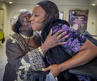 Giles kisses Salome Silombwe  at Lifeway Church in Dallas. It was at Lifeway that Giles learned she could obtain a degree.(Ron Heflin/Special Contributor)
