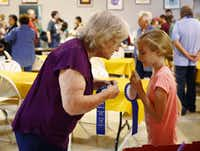 Peggy Garmon talks with her granddaughter Elizabeth Garmon, 11, after she won two first place ribbons during the youth cooking contest at the State Fair of Texas.(Nathan Hunsinger/Staff Photographer)