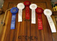 A small sample of Peggy Garmon's winning ribbons from the State Fair of Texas Creative Arts contests are displayed in her kitchen.(Nathan Hunsinger/Staff Photographer)