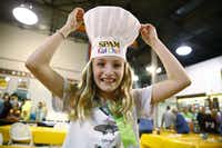 "<p>Allyson Garmon, 11, puts on a chef hat after winning the <span style=""font-size: 1em; background-color: transparent;"">Spam </span><span style=""font-size: 1em; background-color: transparent;"">Kid Chef cooking contest.</span></p>(Nathan Hunsinger/Staff Photographer)"