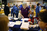 Peggy Garmon brags about her granddaughters to administrators of the contest at the State Fair of Texas on Oct. 6.(Nathan Hunsinger/Staff Photographer)