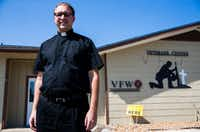 The Rev. Matthew Kinney of Sacred Heart Catholic Church poses for a portrait outside the local VFW Hall, where he and other church leaders feed flood victims three times a week in La Grange. Major flooding damaged hundreds of homes in the city due to flooding from Hurricane Harvey. The rainfall caused the Colorado River, which borders La Grange, to rise to about 54 feet.(Ashley Landis/Staff Photographer)