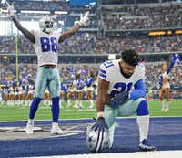 Dallas Cowboys running back Ezekiel Elliott takes a quiet moment before the opening kickoff, as wide receiver Dez Bryant appeals to the crowd before the game against the Green Bay Packers on Sunday at AT&T Stadium.(Louis DeLuca/Staff Photographer)