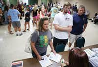 Kim and John Lohrengel helped son Kirby Lohrengel, 19, check in during move-in day at Paris Junior College in August.(Andy Jacobsohn/Staff Photographer)