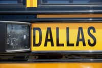 A school bus with cameras sits in the parking lot at the Dallas County Schools headquarters in Dallas.(Andy Jacobsohn/Staff Photographer)