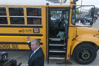 Former Dallas County Schools superintendent Rick D. Sorrells showed off the camera system installed on one of the agency's school buses on April 2, 2014.  The agency's effort to get into the school-bus camera business with a company called Force Multiplier Solutions ended up costing it millions of dollars.(File Photo/DMN)