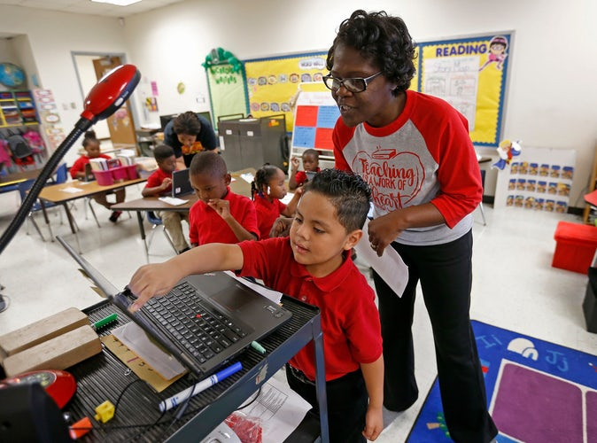 Dallas isd begins push to integrate computer science lessons in teacher vondella rogers helps kindergartner adrian flores with a sequencing drag and drop lesson during a coding class at frederick douglass elementary in malvernweather Gallery