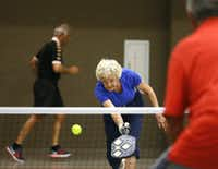 "<span style=""font-weight: normal;"">Inna Guttormson, </span>88, the oldest member of her pickleball club, keeps her eye on the ball as she takes a shot at Carpenter Recreation Center in Plano. (Jae S. Lee/Staff Photographer)"