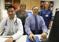 "<p><span style=""font-weight: normal;"">Kim Ludwig</span> (second from left) depends on two health teams to fight multiple myeloma. At UT Southwestern's Simmons Cancer Center, physician's assistant<span style=""font-size: 1em; background-color: transparent;""> Tan Tran (left), Dr. Larry Anderson Jr. and nurse Cynthia Hobbs tend to her. She also travels to the Mayo Clinic to see a hematologist, who confers with the Dallas team.</span></p>(Ron Baselice/Staff Photographer)"