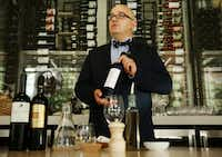 Richard Patino, general manager and wine director of Sachet restaurant, holds a bottle of Assyrtiko wine.(Andy Jacobsohn/Staff Photographer)