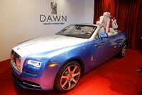 Santa Claus sits in one of the Yours & Mine Exclusive Rolls-Royce Dawn Drophead CoupŽs that was featured at Neiman Marcus' Christmas Book Fantasy Gift Reveal at the Park Place Premier Collection in Dallas, Tuesday, October 17, 2017. (Tom Fox/The Dallas Morning News)(Tom Fox/Staff Photographer)